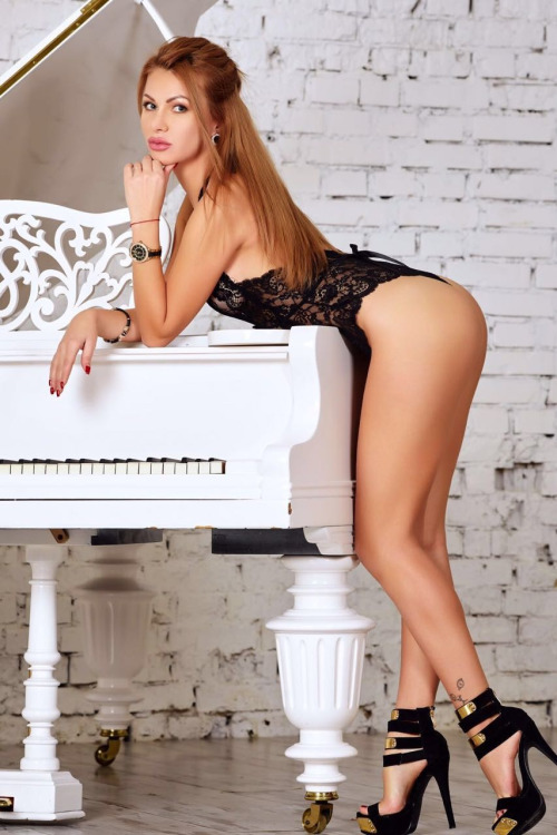 sexy babe on a piano