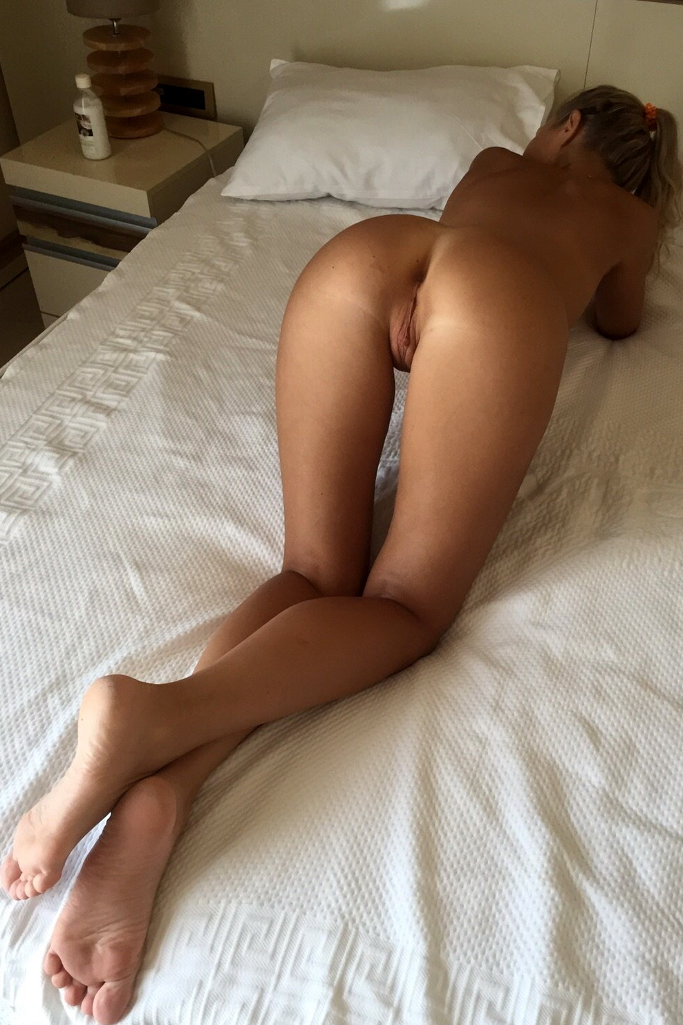 Girl bending over bed nude