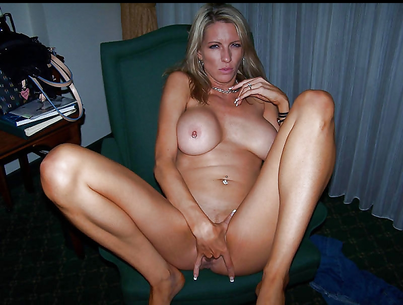 blonde milf fingering herself