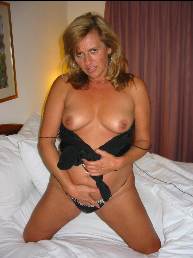 sexy blonde milf on hotel bed